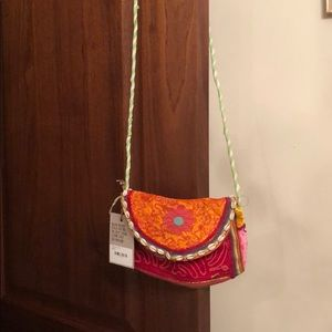 Small colorful bag with cowrie shells